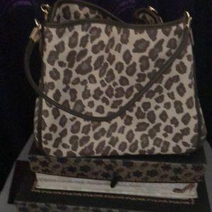Coach cheetah hand bag